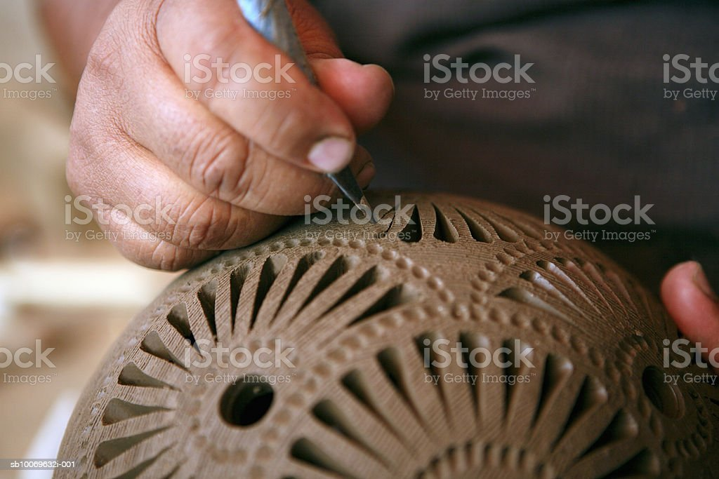 Mexico, Oaxaca, man making black ceramic decorative pottery, close-up of hands royalty-free stock photo