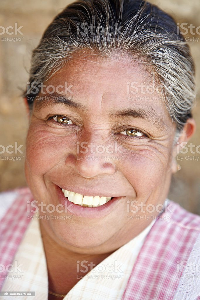 Mexico, Oaxaca, Portrait of mature woman smiling, close-up royalty-free stock photo