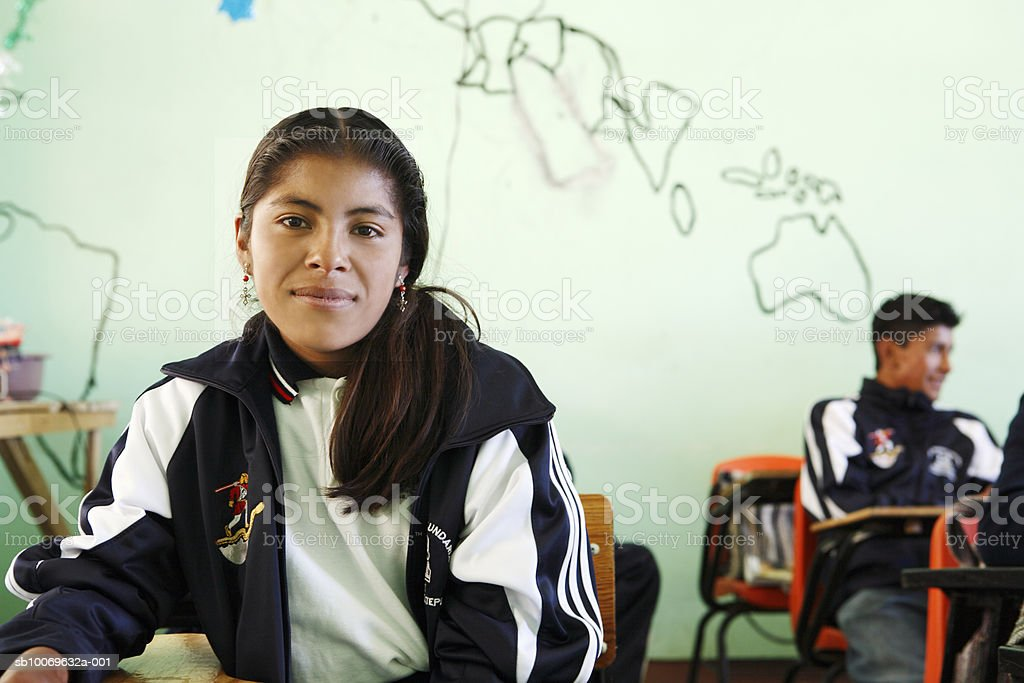 Mexico, Oaxaca, Portrait of teenage girl (14-15) in classroom royalty free stockfoto