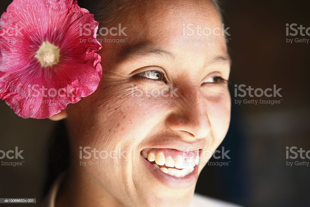 Mexico, Oaxaca, Young woman with flower in head royalty free stockfoto