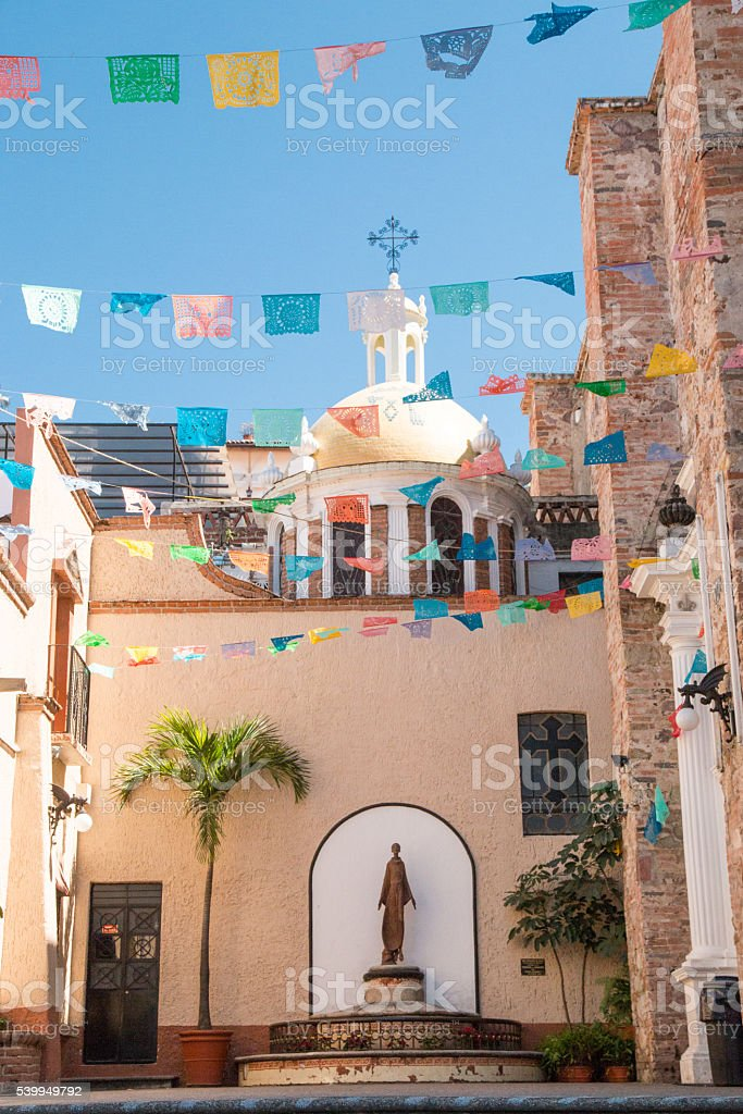 Mexico, Puerto Vallarta. Our Lady of Guadalupe Parish Church courtyard stock photo