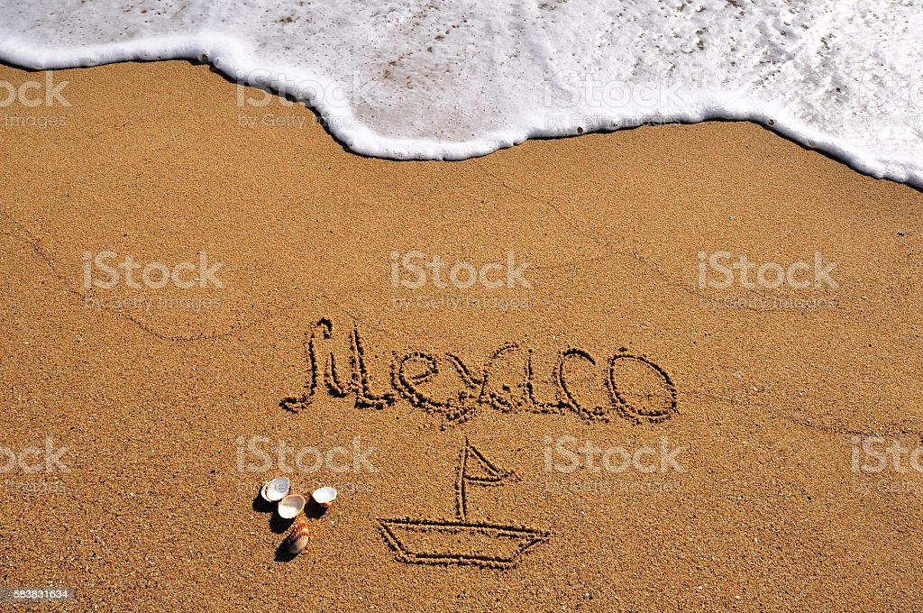 Mexico sign in the sand stock photo