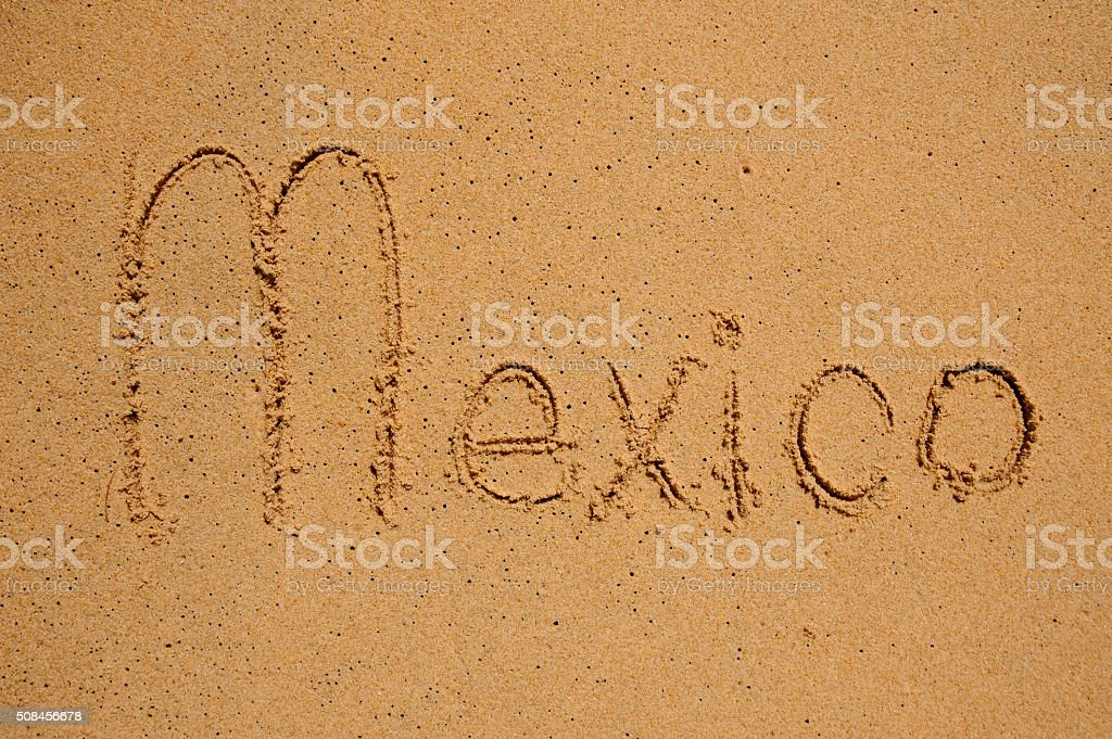 Mexico sign on the beach sand stock photo