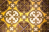 Mexico Style: Antique Floor Tiles in Brown and Gold