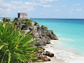 The dazzling Caribbean Sea is the backdrop for the ancient Mayan ruins at Tulum Mexico.