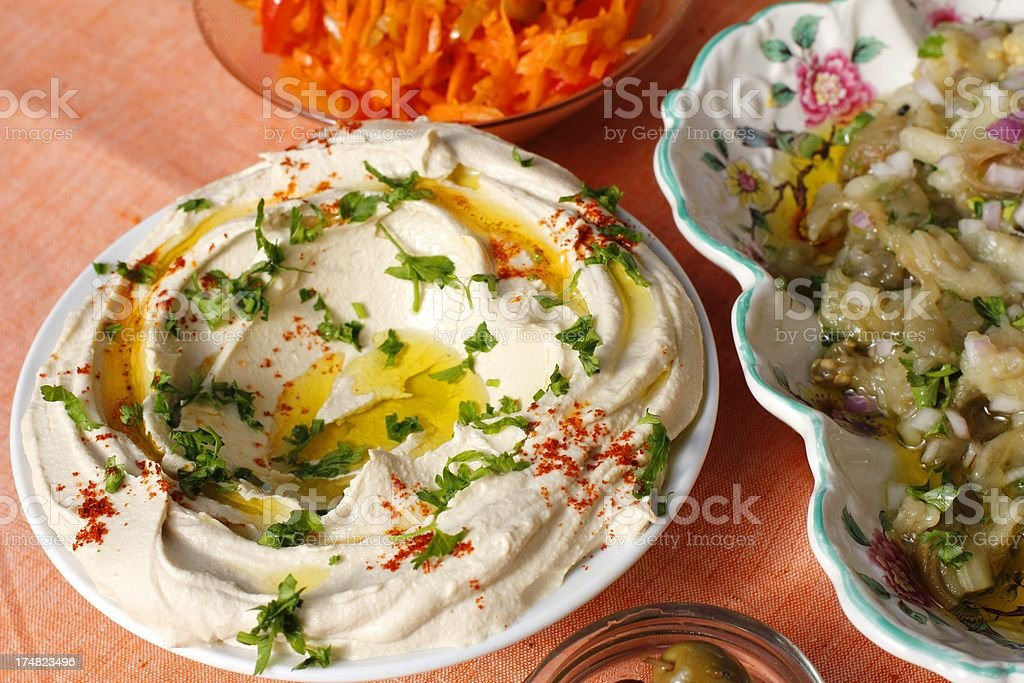 Meze: Hummus, Baba Ghanoush, Olives, Carrot salad stock photo