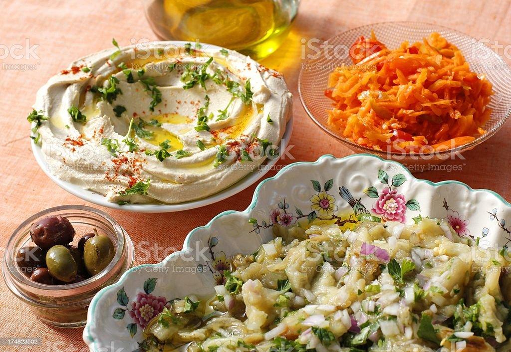 Mezze: Hummus, Baba Ghanoush , Olives, Carrot salad stock photo