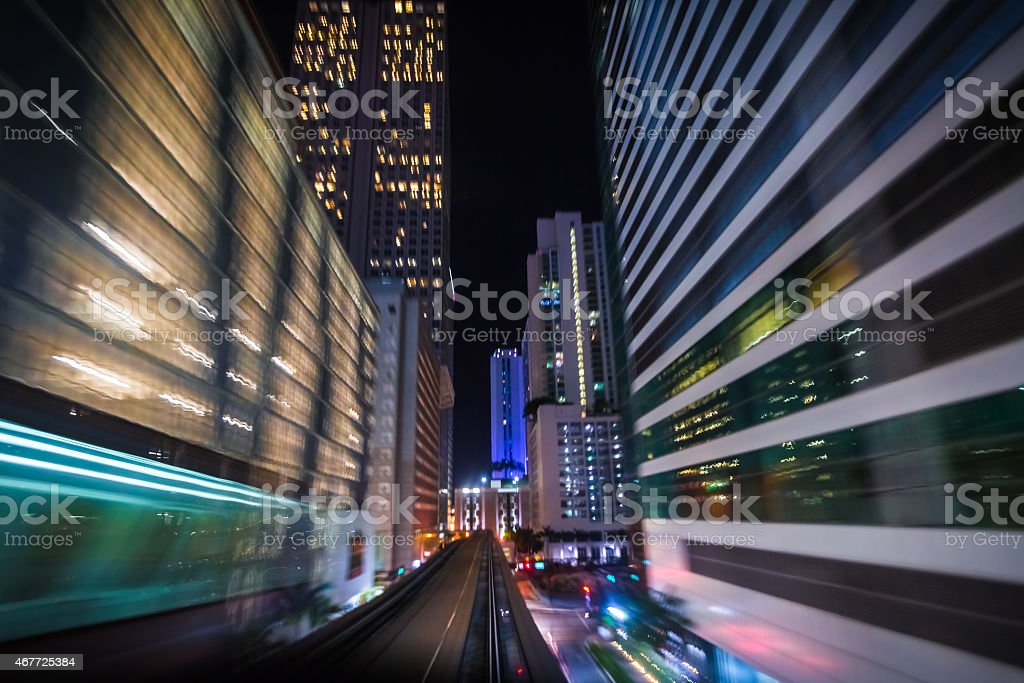 Miami at Night seen from moving metromover stock photo