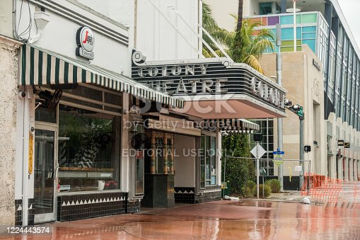 Miami Beach, FL, United States - May 10, 2020 - The Colony Theatre, an art deco building opened in 1935, sits between a restaurant and a movie theater on Lincoln Road Mall in South Beach.