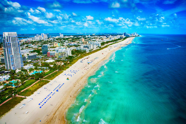 Miami Beach Florida From Above The white sands and turquoise ocean of beautiful Miami Beach, Florida as shot from an altitude of about 500 feet during a helicopter photo flight. miami beach stock pictures, royalty-free photos & images