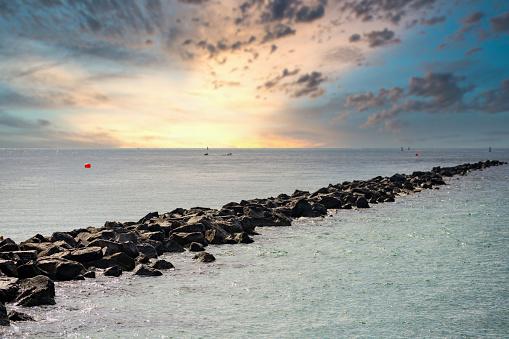 Miami Beach jetty to the ocean with sunrise sky USA