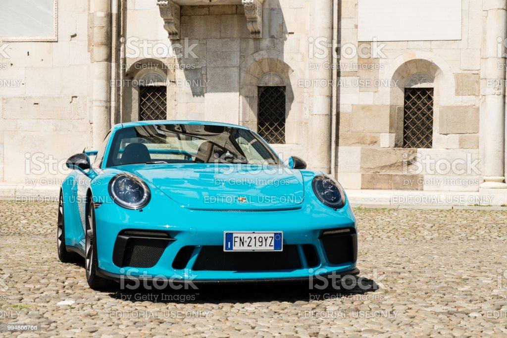 A Miami blue Porsche 911 GT3 in the Piazza Grande square MODENA, ITALY - June, 2018. A Miami blue Porsche 911 GT3 in the Piazza Grande square Blue Stock Photo
