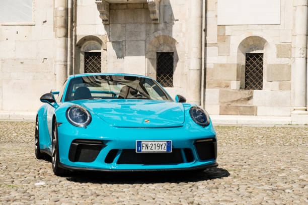 A Miami blue Porsche 911 GT3 in the Piazza Grande square MODENA, ITALY - June, 2018. A Miami blue Porsche 911 GT3 in the Piazza Grande square porsche stock pictures, royalty-free photos & images