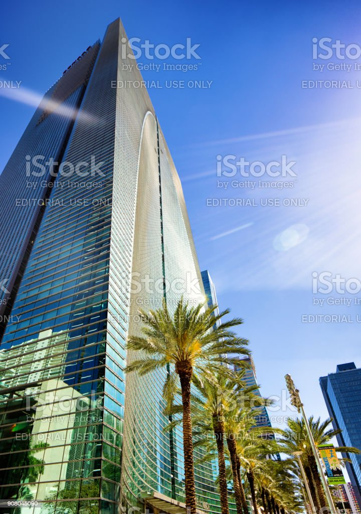 Miami Brickell Arch modern office skyscraper tilted low angle view with lens flare stock photo