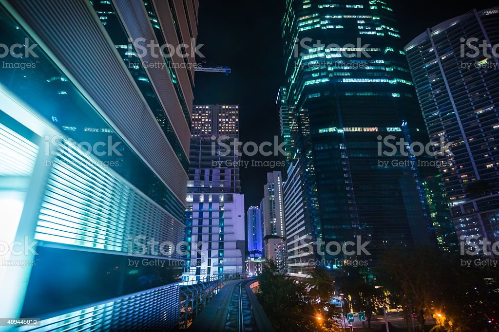 Miami city lights at night seen from moving metromover stock photo