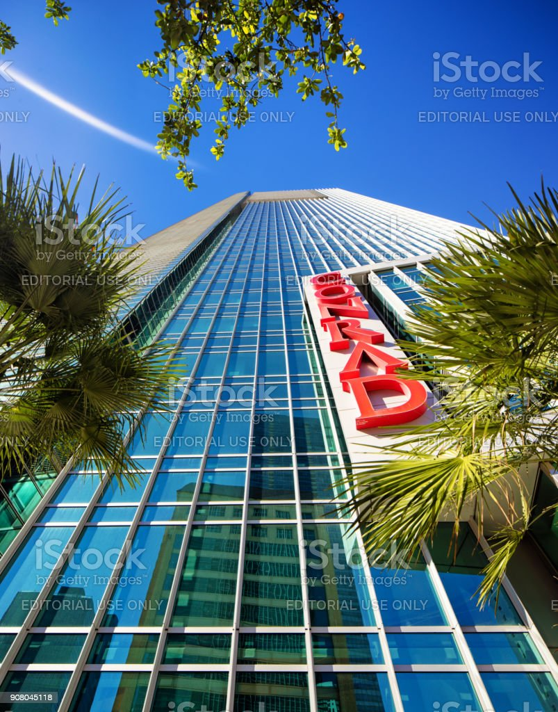 Miami Conrad hotel modern skyscraper tilted low angle view with lens flare stock photo