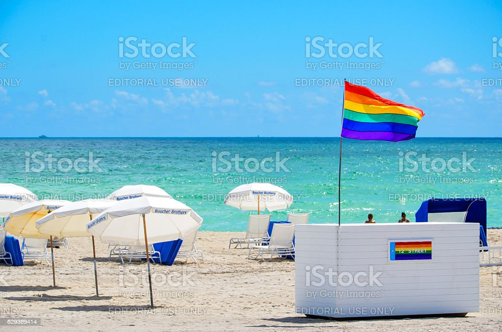 Miami Gay Pride Rainbow Flag on Beach stock photo