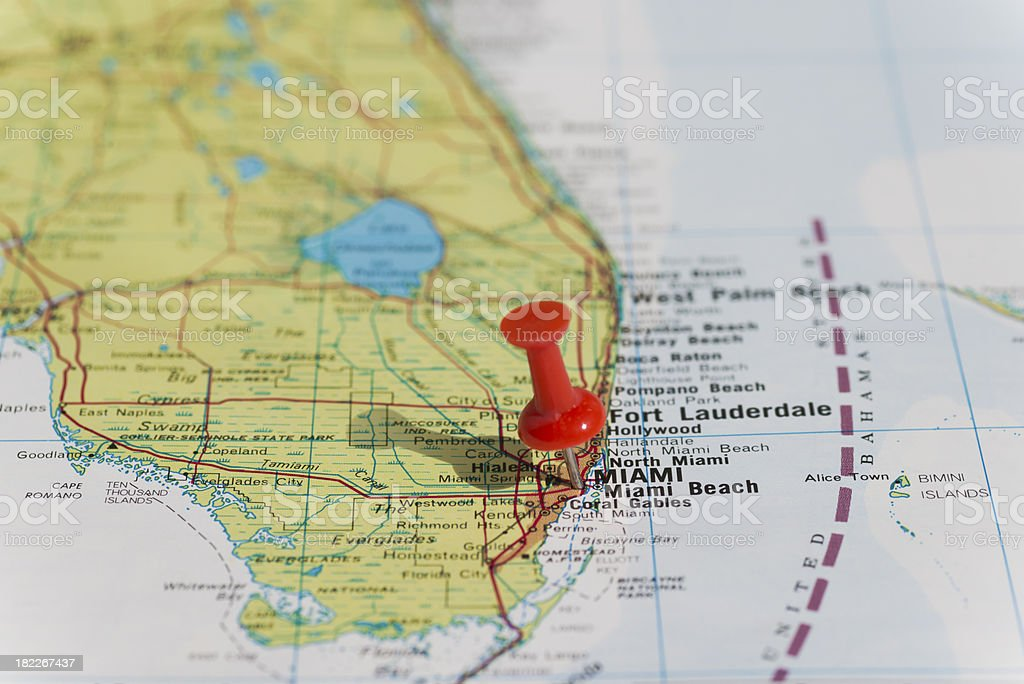 Miami marked on map with red pushpin. Selective focus on the word...