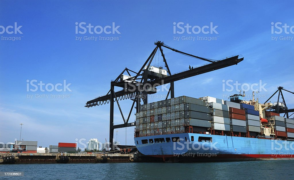 miami seaport crane and container cargo ship royalty-free stock photo