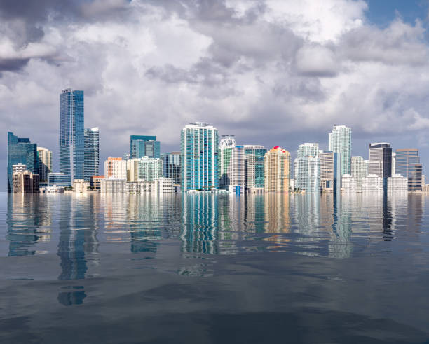 Miami skyline concept of sea level rise and flooding from global warming stock photo