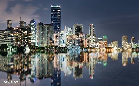 istock Miami Skyline reflection at Night Across Biscayne Bay 1073444306