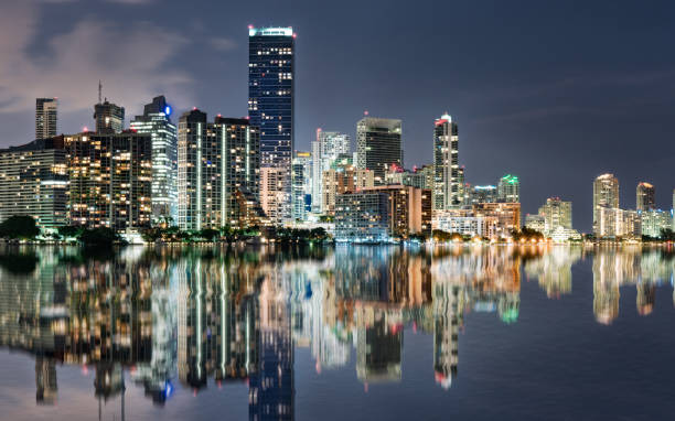Miami Skyline reflection at Night Across Biscayne Bay stock photo