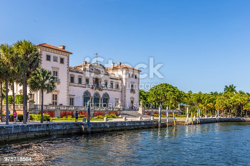 MIAMI, USA - AUG 24, 2014: Miami Vizcaya museum at waterfront under blue sky on Biscayne Bay in the Coconut Grove neighborhood of Miami, Florida.