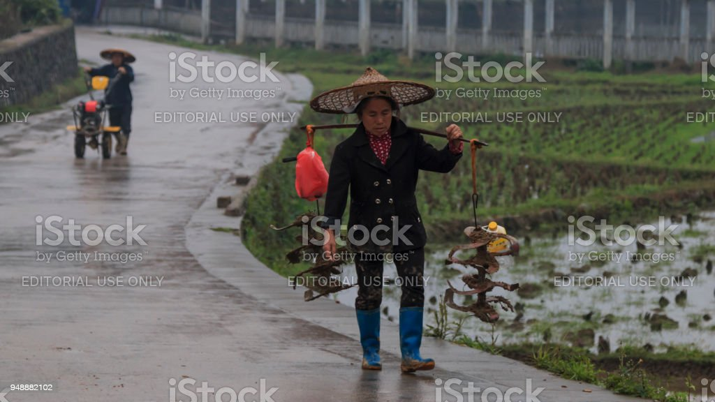 Miao farmers going back home in Langde Miao village, Guizhou province, China stock photo