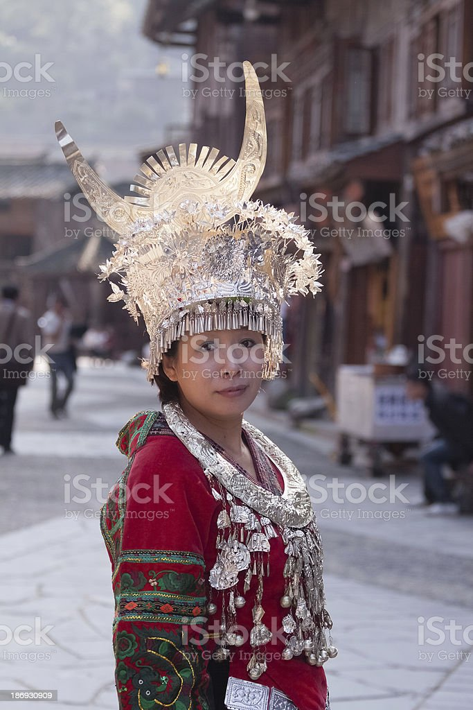 Miao girl standing in the street stock photo