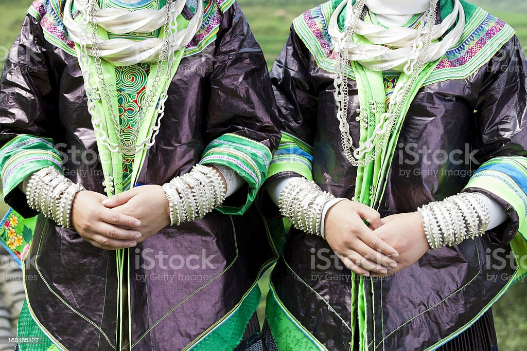 Miao Girl's Hands With Silver Bracelets stock photo