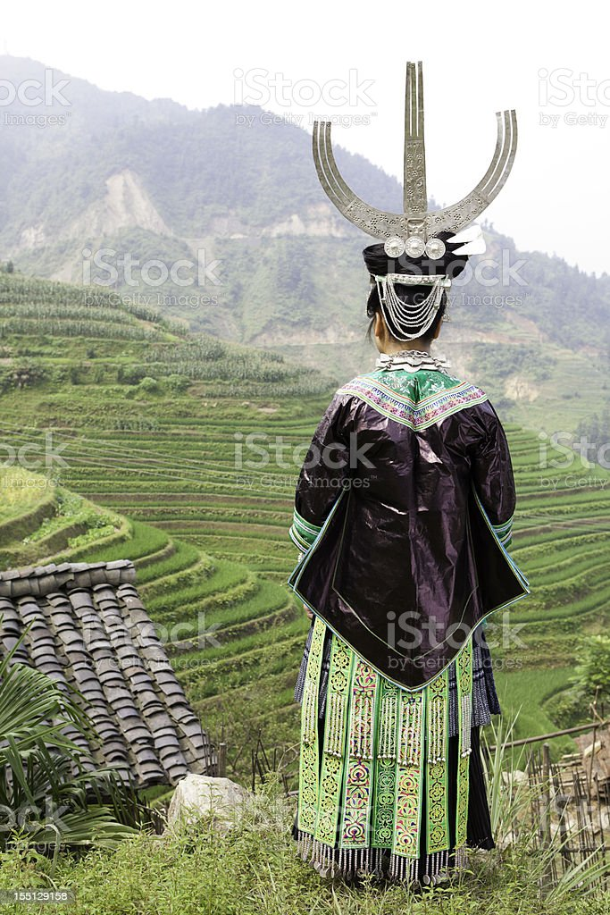 Miao Girl's Silver Headwear And Clothes stock photo