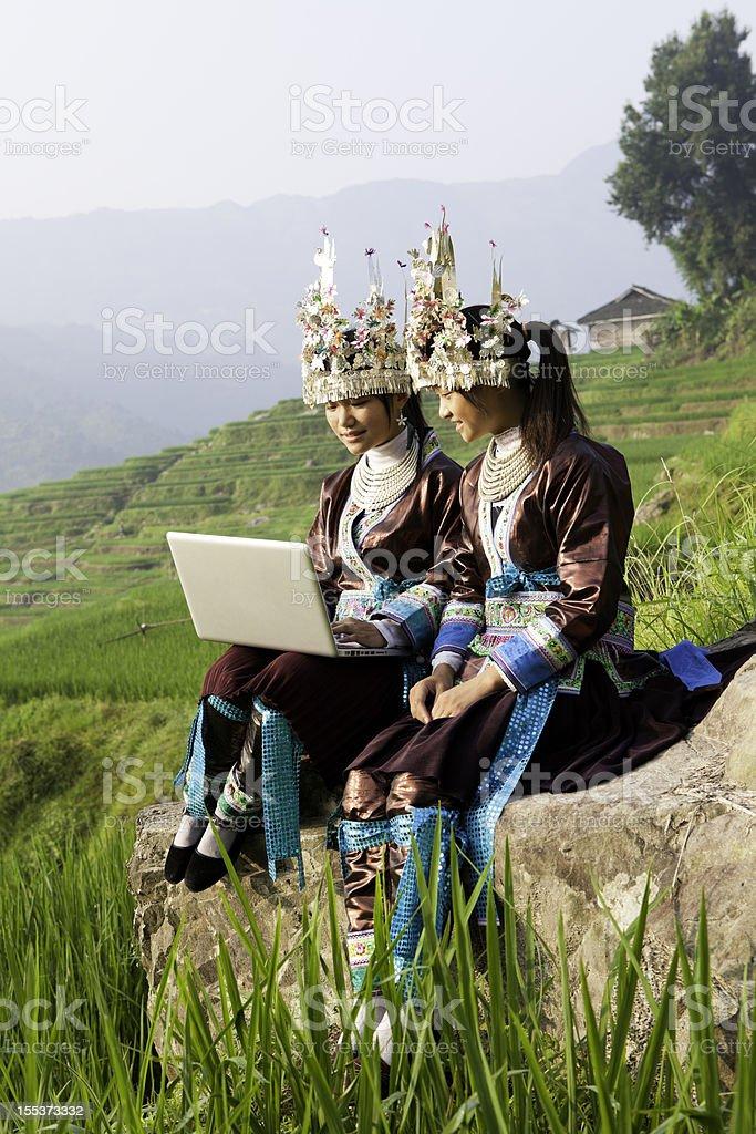 Miao Girls Use Laptop royalty-free stock photo