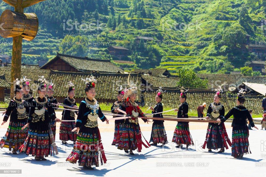 Miao Minority Women Ribbon Dance Festival Xijiang stock photo
