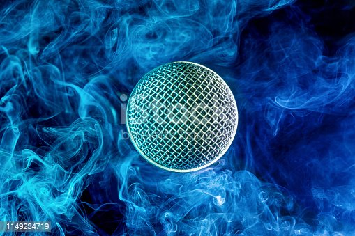 istock mic in a blue cloud of smoke 1149234719