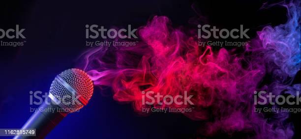 Mic in a smoky stage picture id1162815749?b=1&k=6&m=1162815749&s=612x612&h=vx3qfjxmv9lvnngx9ac4ksagxcarc0p0vts0giwvjja=