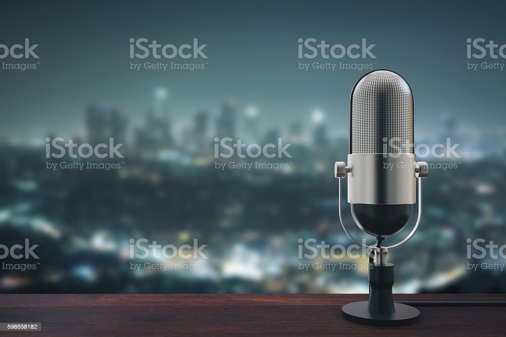 Mic on night city background stock photo