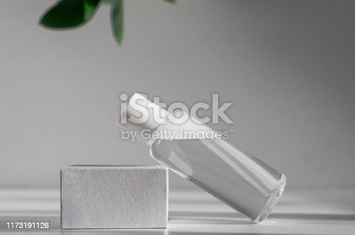 istock Micellar water, makeup remover mockup side view. Natural cosmetology product, organic cosmetics poster concept. Moisturizing lotion bottle with leaves on background. Women skin care, hygiene concept 1173191126