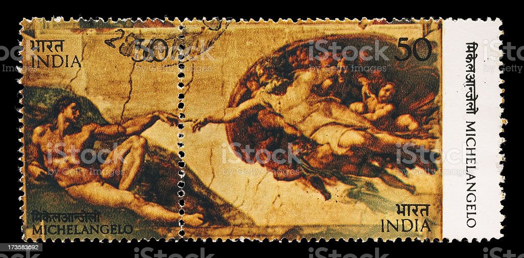 Michelangelo's Creation of Adam postage stamps royalty-free stock photo