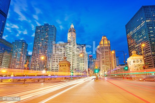 Long exposure stock photograph of cars passing on Michigan Avenue in downtown Chicago Illinois USA at twilight blue hour.