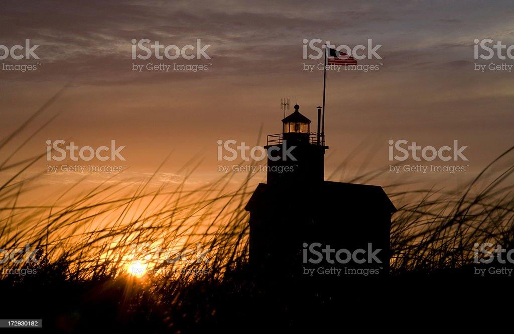 Michigan lighthouse during sunset stock photo