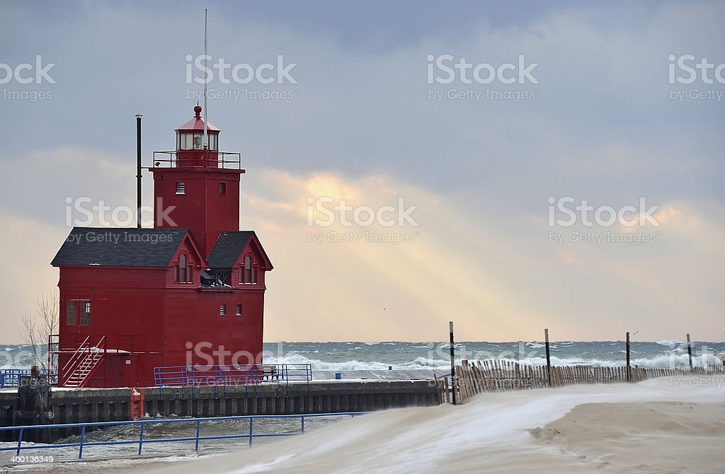 Michigan red lighthouse in winter stock photo
