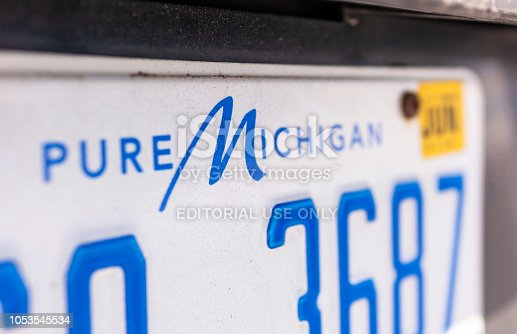 Spanish Fork, Utah - Close-up on the words 'Pure Michigan', at the top of a license plate for a vehicle registered in the state.
