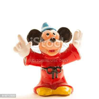 Fosston, USA - April 5, 2016: A vintage Mickey Mouse toy figurine.  Mickey was created by Walt Disney and Ub Iwerks at the Walt Disney Studios in 1928 and is the official mascot of The Walt Disney Company.  Mickey's first appearance was in one of the first sound cartoons, Steamboat Willie on November 18, 1928.