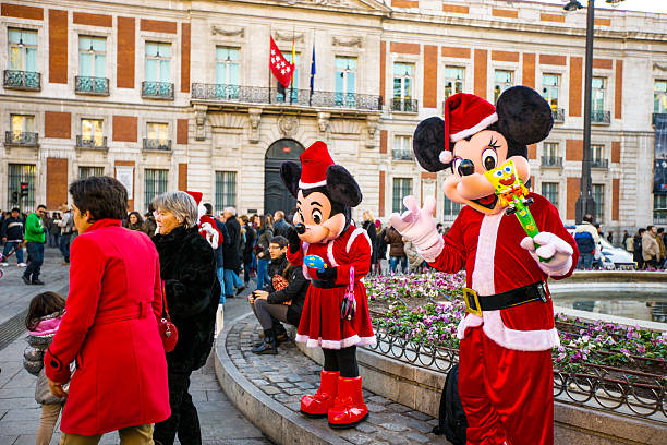 Mickey mouses in santas costumes on puerto del sol madrid picture id516396725?b=1&k=6&m=516396725&s=612x612&w=0&h=pcv9teusiom0akhv8amhfn28kbe7rc0yvl17ethtyj4=