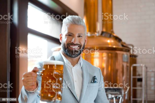Micro Brewery Owner With A Mug Of Fresh Beer Stock Photo - Download Image Now