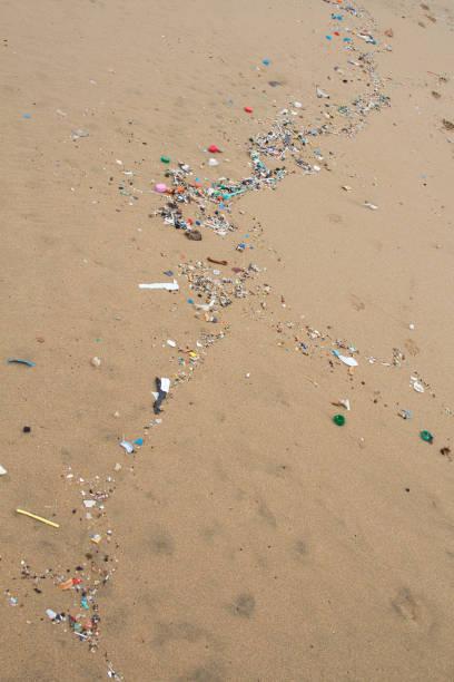 Micro plastic rubbish washed up on the sea shore. stock photo