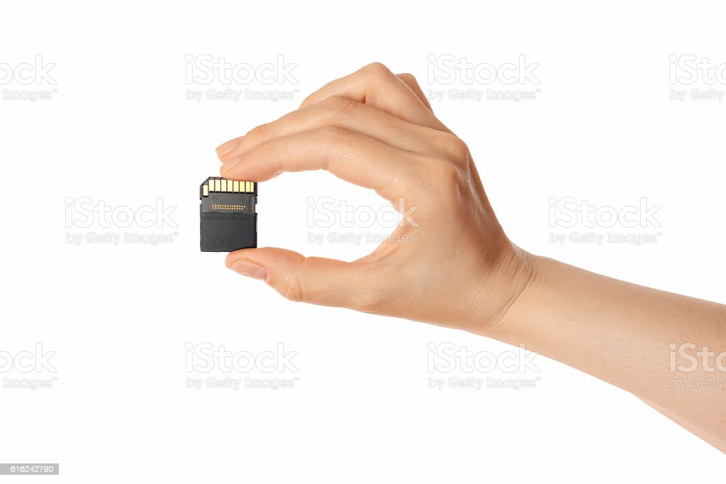 micro sd card and hand (isolated) stock photo