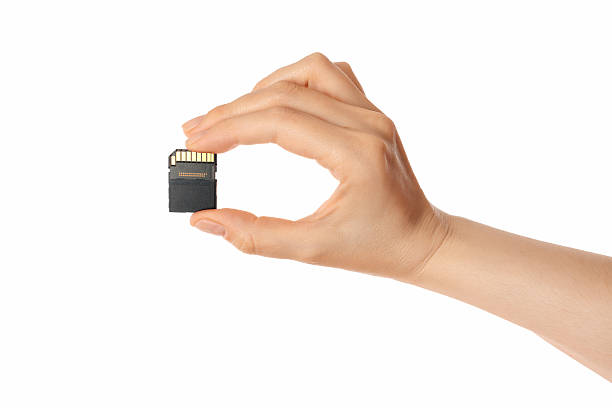 micro sd card and hand (isolated) - memory card stock photos and pictures