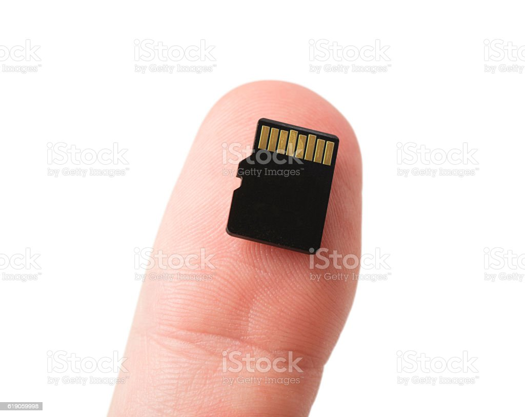 Micro SD Card on Thumb stock photo