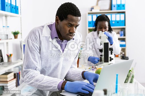 Microbiologists in laboratory